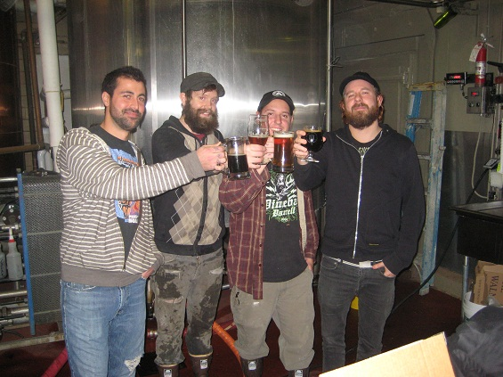 Anders Fridén, far right, takes a break with the brewers at Great Divide.