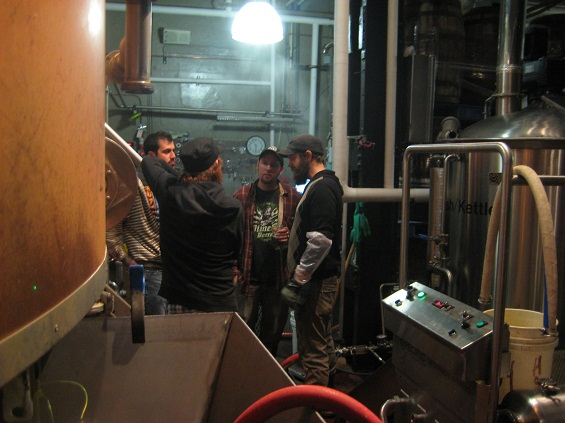 Discussing the progress of the brew.