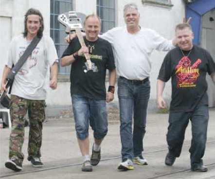 Pictured: METALRUZZ (Kim Thyge Jensen is second from right, wearing a white long-sleeved shirt) Photo courtesy of Ugenyt