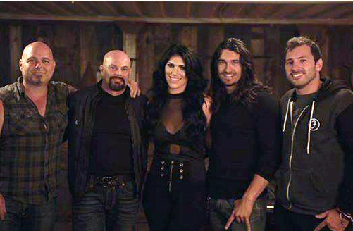"On the set of ""Bittersweet Seduction"":  Guitarist Eric Horton and Lead Vocalist Jon Campos  with Ashley Ridge, their ""lovely and talented leading lady"", Mattias Anderson DeCosta,  their ""lovely and talented leading man"", and friend Henry from Germany."