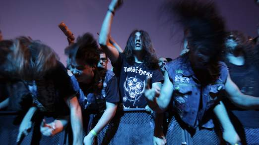 Fans of the band Motorhead shake their heads during their performance at the 35th Paleo music festival in Nyon