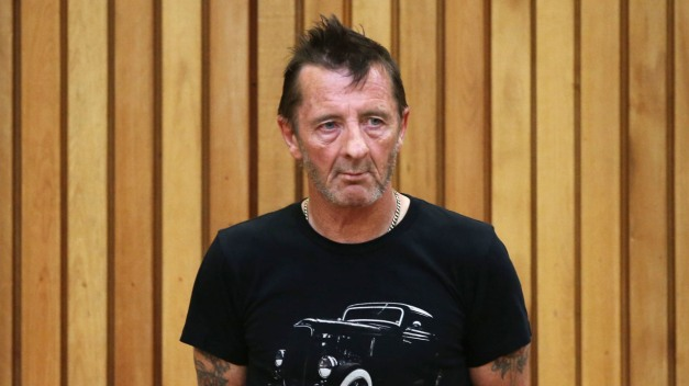 TAURANGA, NEW ZEALAND - NOVEMBER 26:  AC/DC drummer Phil Rudd appears in court after being charged with threatening to kill and possession of meth and marijuana at Tauranga District Court on November 26, 2014 in Tauranga, New Zealand.  Phil Rudd was ACDC's drummer from 1975 to 1983.  (Photo by Joel Ford/Getty Images)