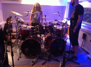 Samuel with Fotis and George Bokos (guitars, bass and vocals)